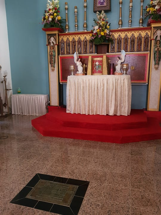 Fr. Jesus Baza Duenas is buried near the altar of St. Joseph Church in Inarajan. A plaque that marks his entombment is shown in this April 26, 2019 photo.