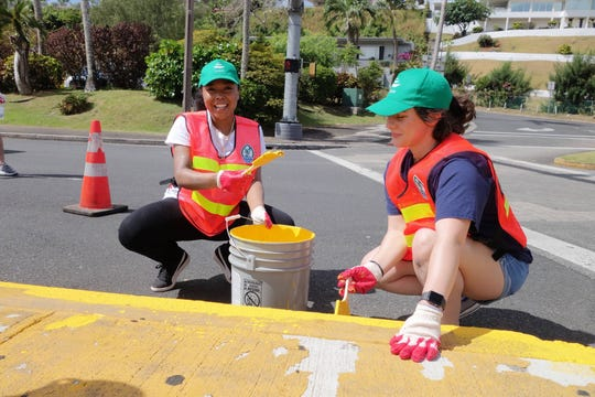 The Guam Visitors Bureau, Department of Public Worksand volunteers from the Andersen Air Force Base Sister Village Program painted medians in Tumon recently.