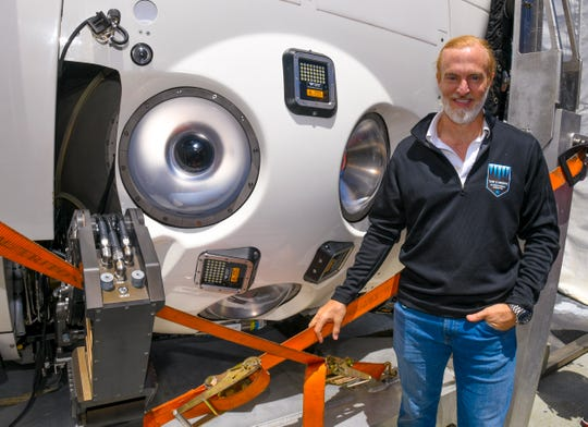 Industrialist Victor Vescovo, founder and financier of The Five Deeps Expedition, stands besides the portals built into the world's first two-person, titanium-hulled submersible, DSV Limiting Factor, during the vessel's visit to the Port Authority of Guam on Friday, April 26, 2019. Vescovo has set his sight on being the first person to make multiple dives into the Challenger Deep.
