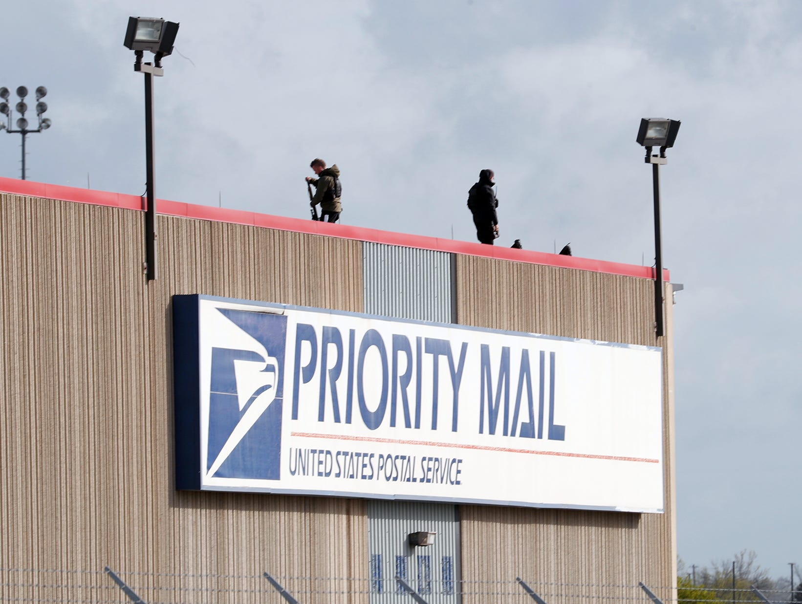 Snipers set up on the roof of the United States Postal Service hub at the Indianapolis International Airport prior to the arrival of President Donald Trump and Vice President Mike Pence on April 26, 2019.