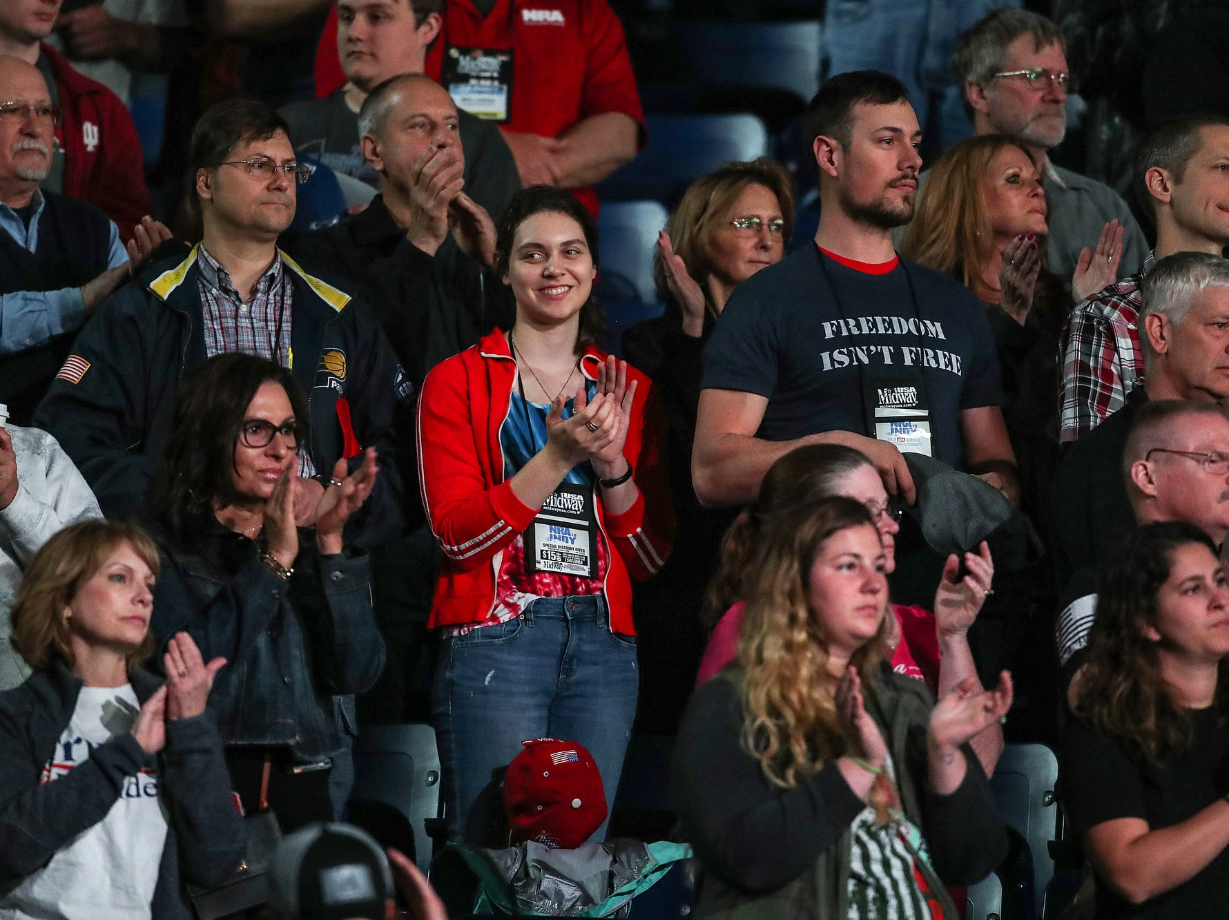 Spectators cheer as the National Rifle Association Institute for Legislative Action Leadership Forum begins, Friday, April 26, 2019, at Lucas Oil Stadium in Indianapolis.