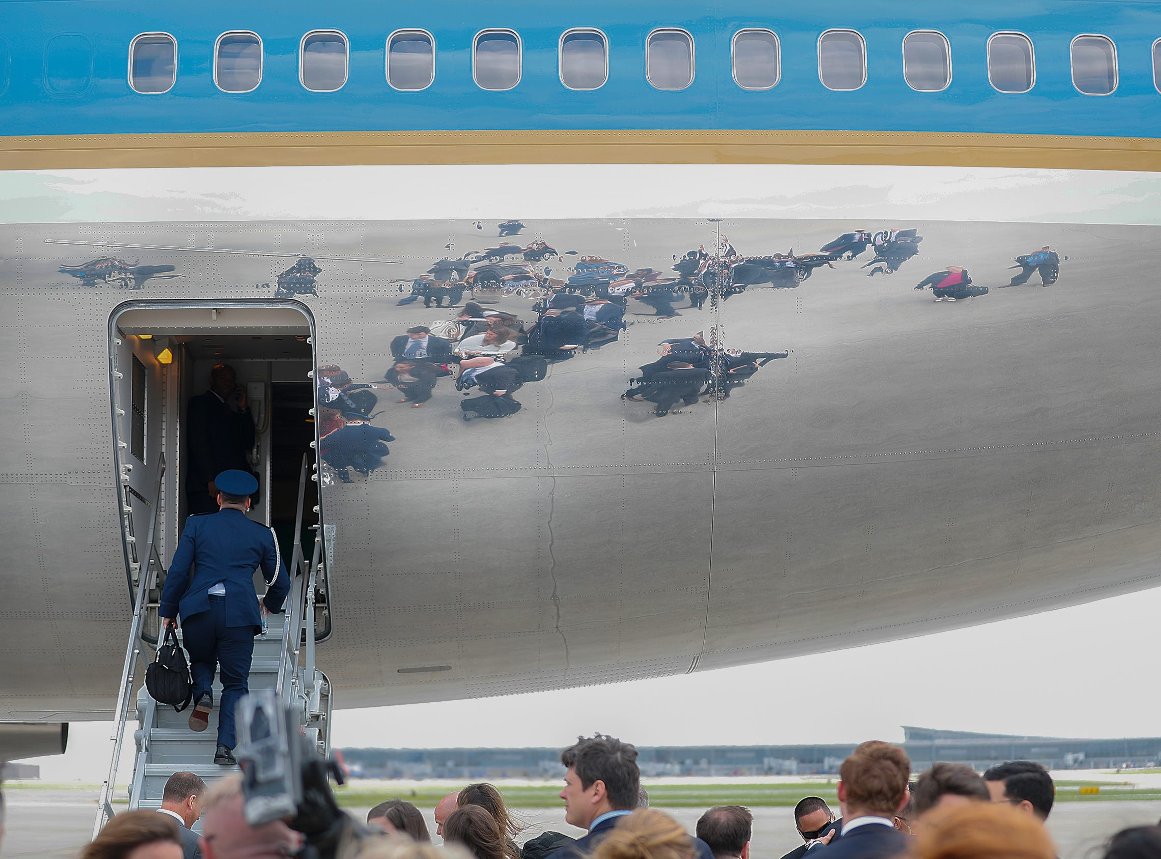 Support personal and the national media board the rear of Air Force One as they prepare to depart Indianapolis International Airport. President Donald Trump and VP Mike Pence spoke at the NRA-ILA Leadership Forum at Lucas Oil Stadium on Friday, April 26, 2019.