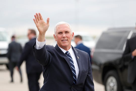 Vice President Mike Pence waves to the crowd that greeted the vice president at the Indianapolis International Airport on Friday, April 26, 2019. Pence was in town to speak before the 2019 NRA Meeting and Exhibit at Lucas Oil Stadium.