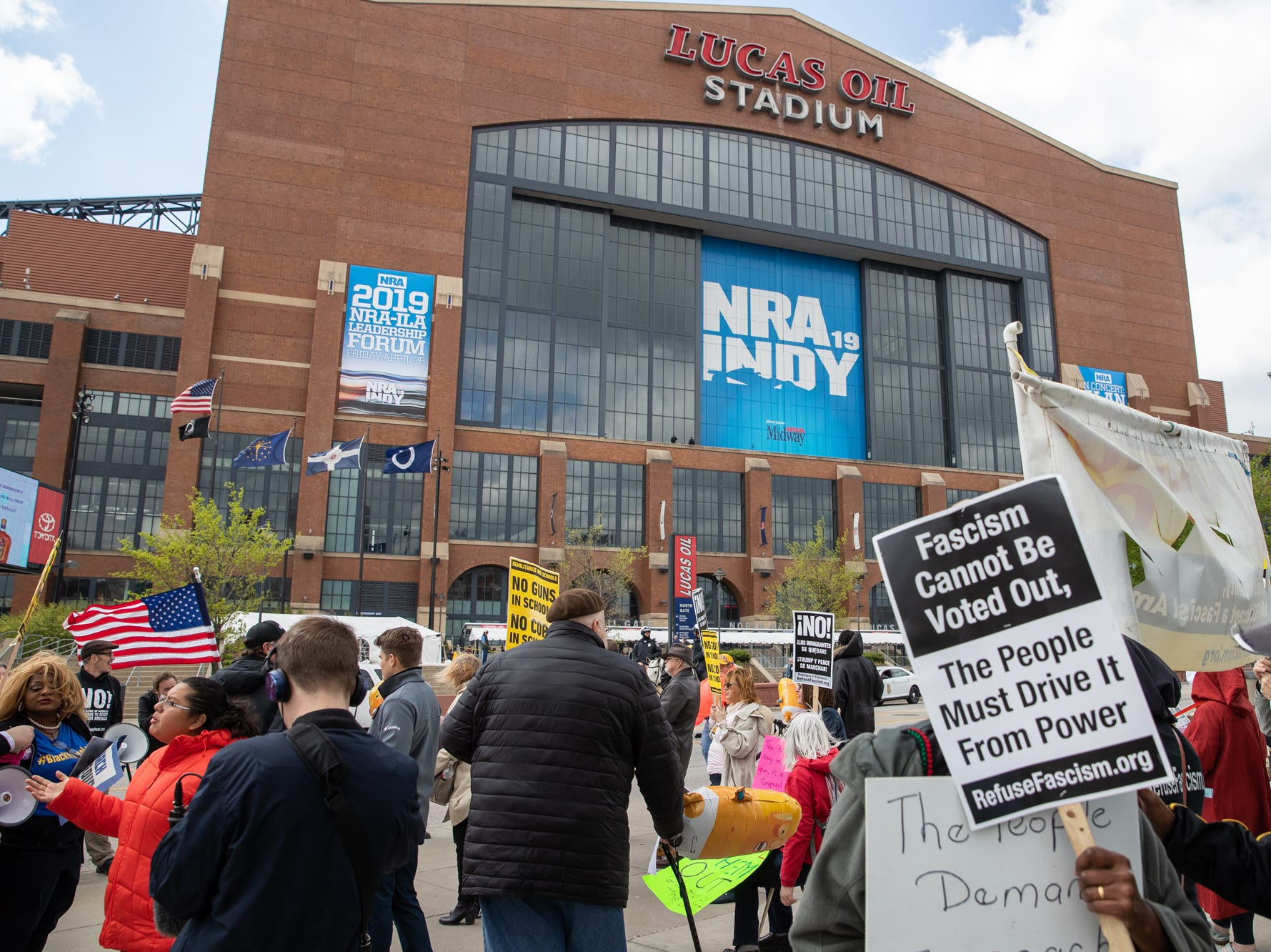 Protesters chant outside Lucas Oil Stadium during President Donald Trump's speech during the at the National Rifle Association Institute for Legislative Action on Friday, April 26, 2019.