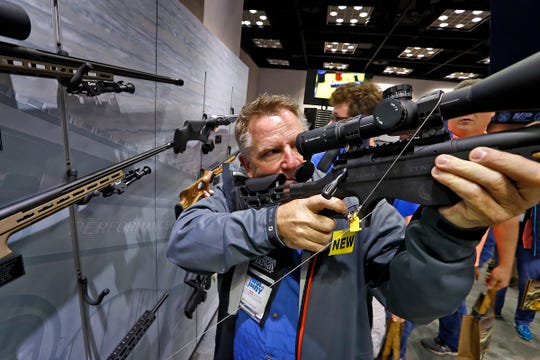 John Jackson, from Fishers, tries firearms at the Smith & Wesson high performance area during the 2019 NRA convention exhibits at the Indiana Convention Center, Friday, April 26, 2019.