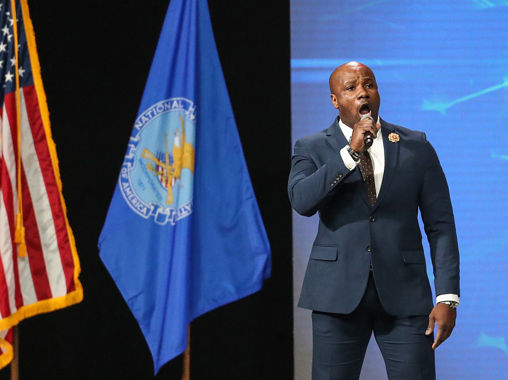IMPD officer Chris Wilburn sings the National Anthem before the National Rifle Association Institute for Legislative Action Leadership Forum, Friday, April 26, 2019, at Lucas Oil Stadium in Indianapolis.