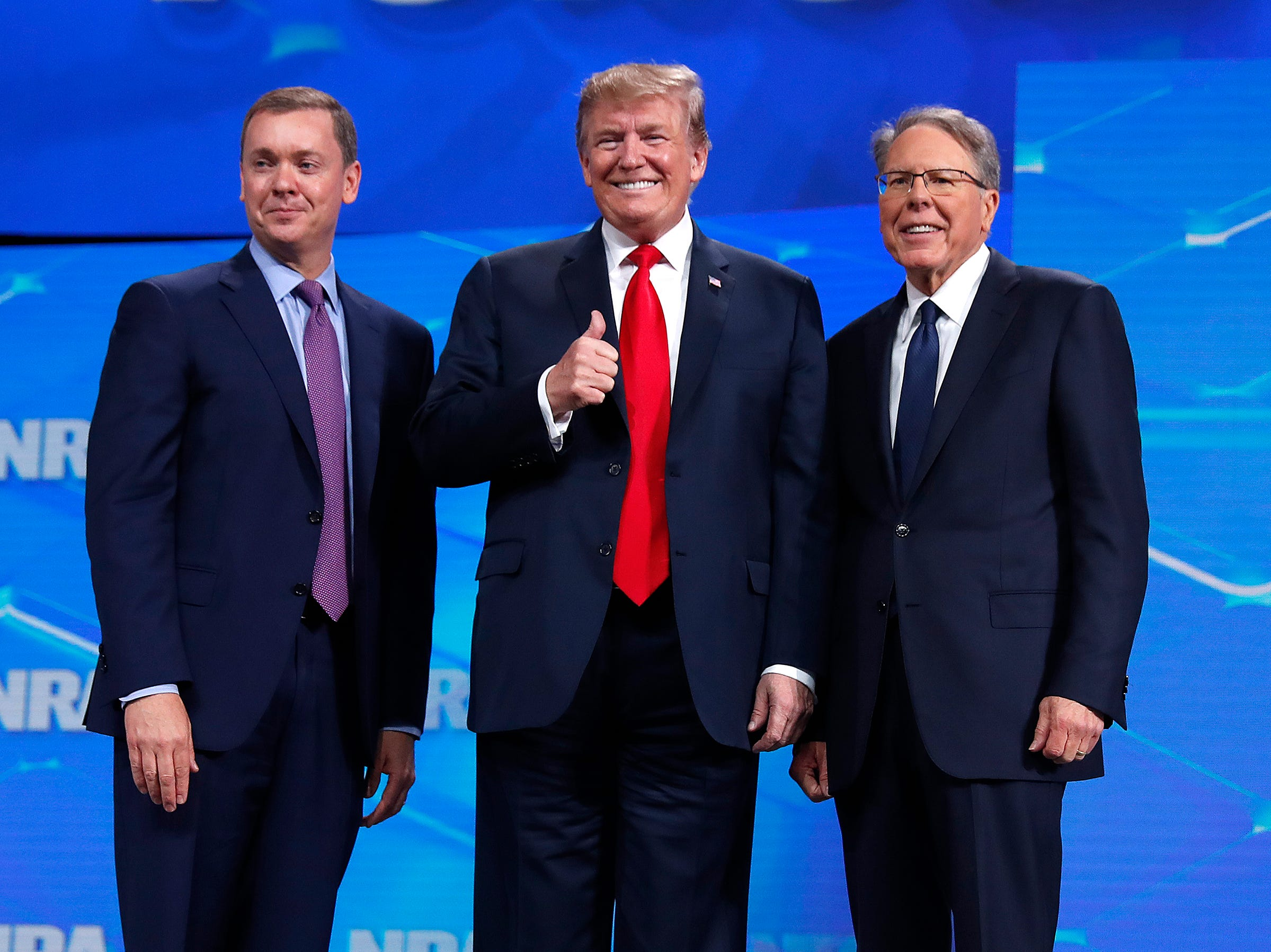 President Donald Trump with Chris Cox, Executive Director of the National Rifle Association's Institute for Legislative Action, right, and Wayne LaPierre, Executive Vice President and Chief Executive Officer of the NRA, left. President Trump addressed the National Rifle Association Institute for Legislative Action Leadership Forum, Friday, April 26, 2019, at Lucas Oil Stadium in Indianapolis. The forum is part of the 148th NRA annual meetings and exhibits in Indianapolis.