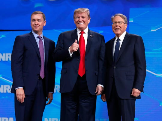 President Donald Trump with Chris Cox, Executive Director of the National Rifle Association's Institute for Legislative Action, left, and Wayne LaPierre, Executive Vice President and Chief Executive Officer of the NRA, right.