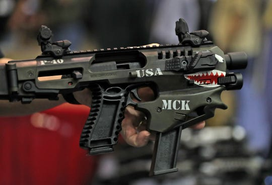 A MCK (Micro Conversion Kit) made by CAA is seen at the 2019 NRA convention exhibits at the Indiana Convention Center, Friday, April 26, 2019.  The kit turns most handguns into short-barreled rifles.