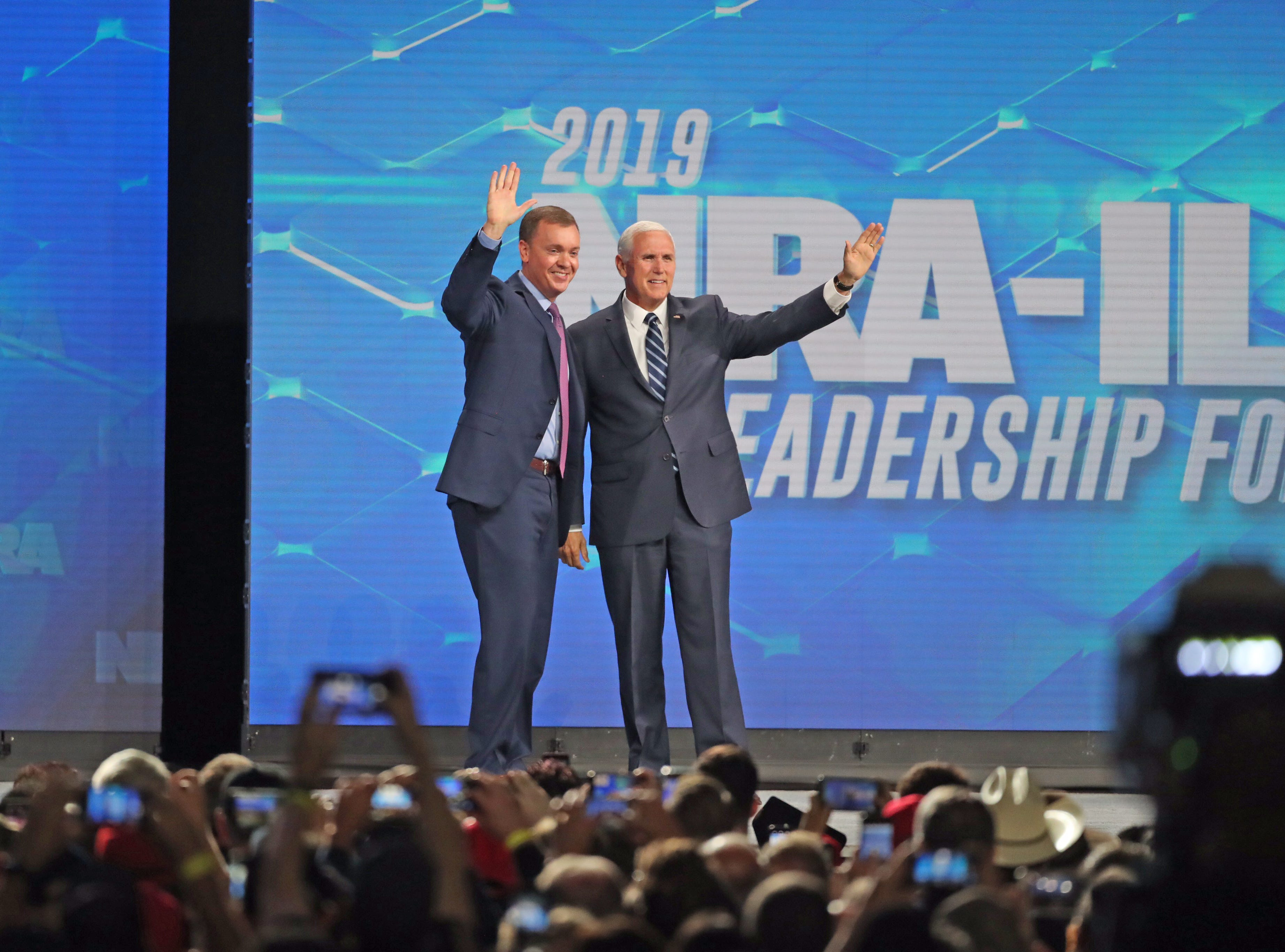 Chris Cox, executive director of the NRA Institute for Legislative Action with Vice President Mike Pence at the Leadership Forum at Lucas Oil Stadium on Friday, April 26, 2019.