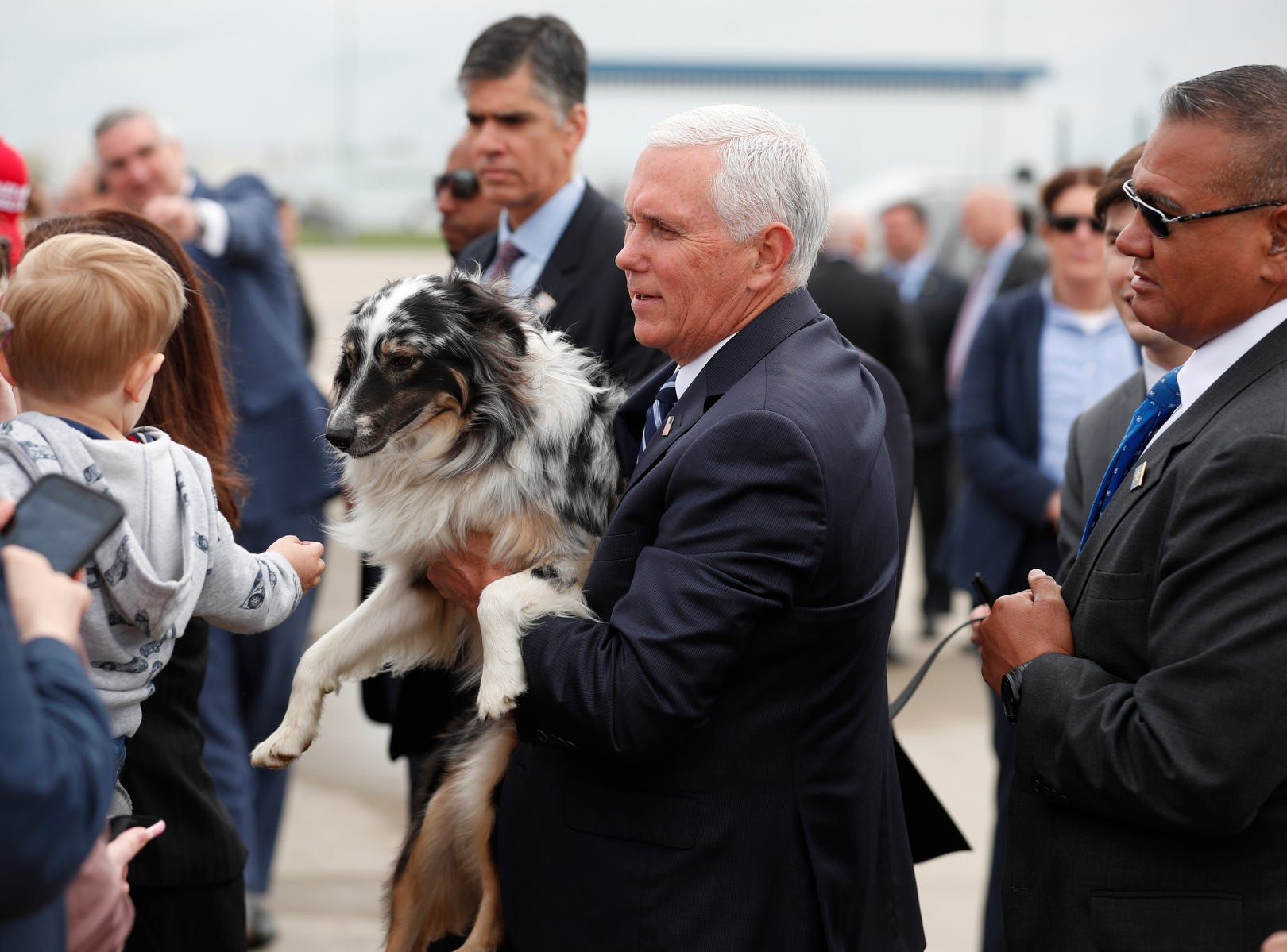 Vice President Mike Pence holds up his dog, Harley for a young boy in the crowd to pet. A crowd greeted the vice president at the Indianapolis International Airport on Friday, April 26, 2019. Pence was in town to speak before the 2019 NRA Meeting and Exhibit at Lucas Oil Stadium.