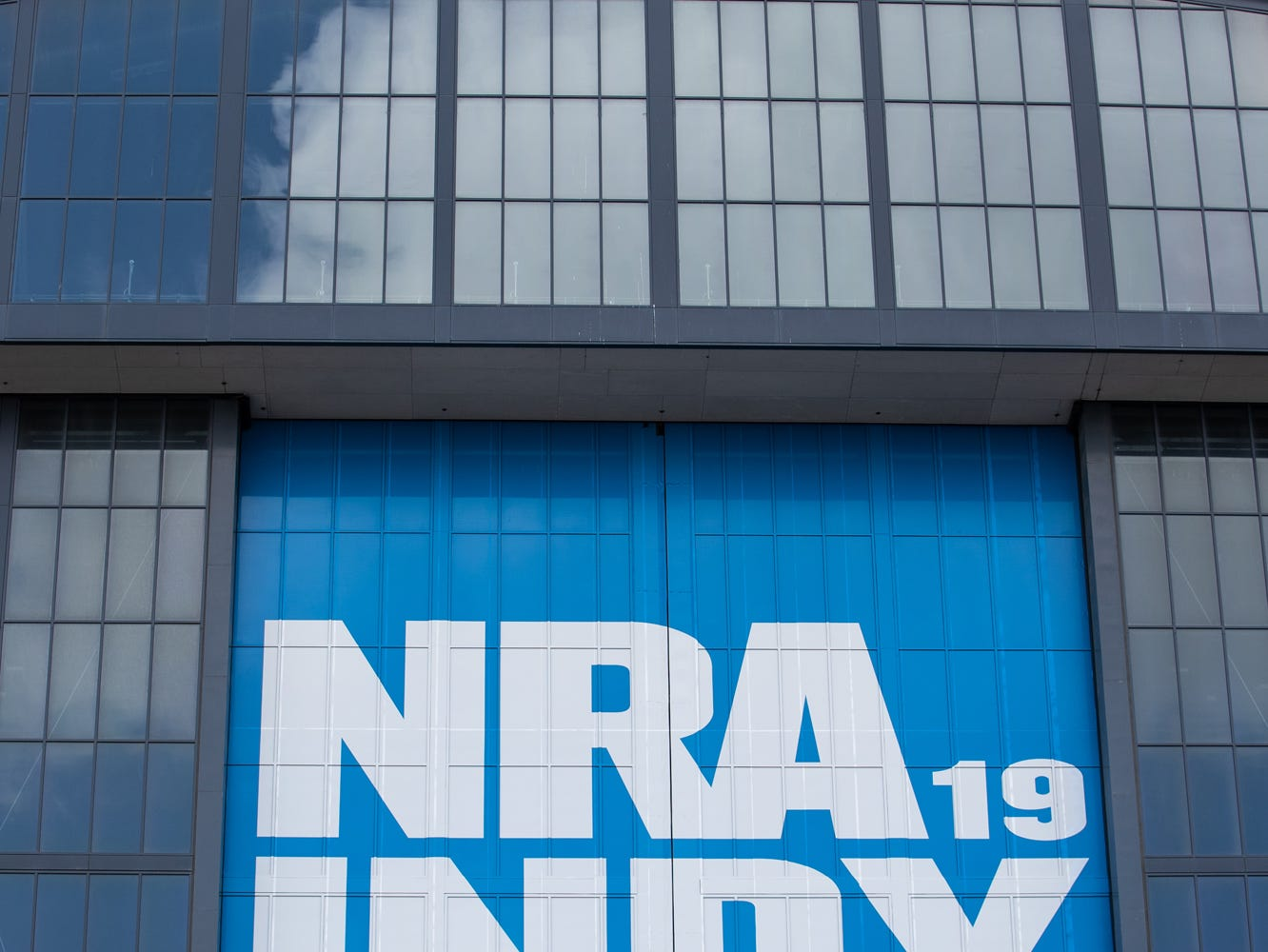 Law enforcement stand watch near the retractable wall at Lucas Oil Stadium during President Donald Trump's speech during the National Rifle Association Institute for Legislative Action in Indianapolis on Friday, April 26, 2019.