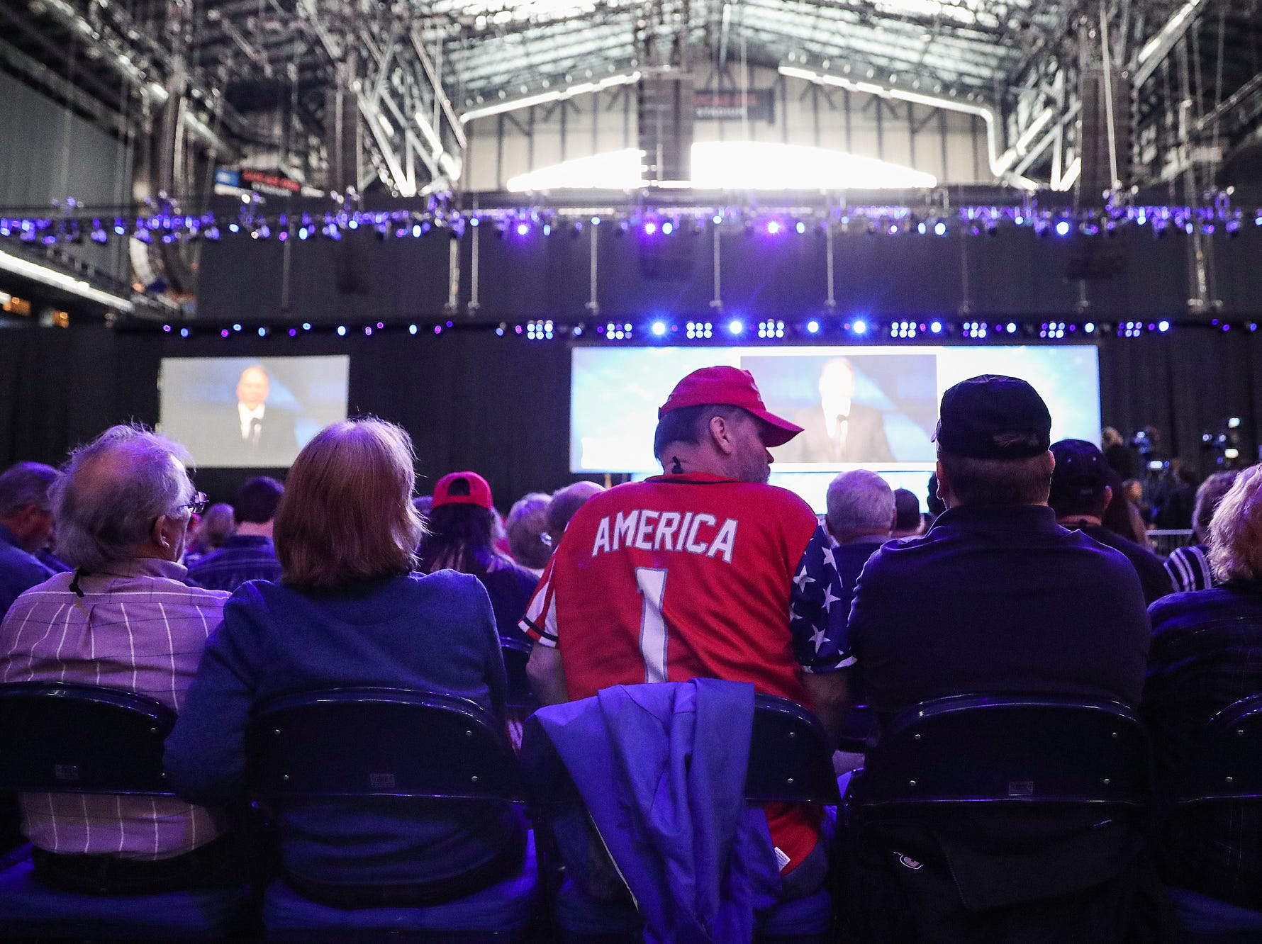 Spectators wait for the National Rifle Association Institute for Legislative Action Leadership Forum to begin, Friday, April 26, 2019, at Lucas Oil Stadium in Indianapolis. The forum is part of the 148th NRA annual meetings and exhibits in Indianapolis.