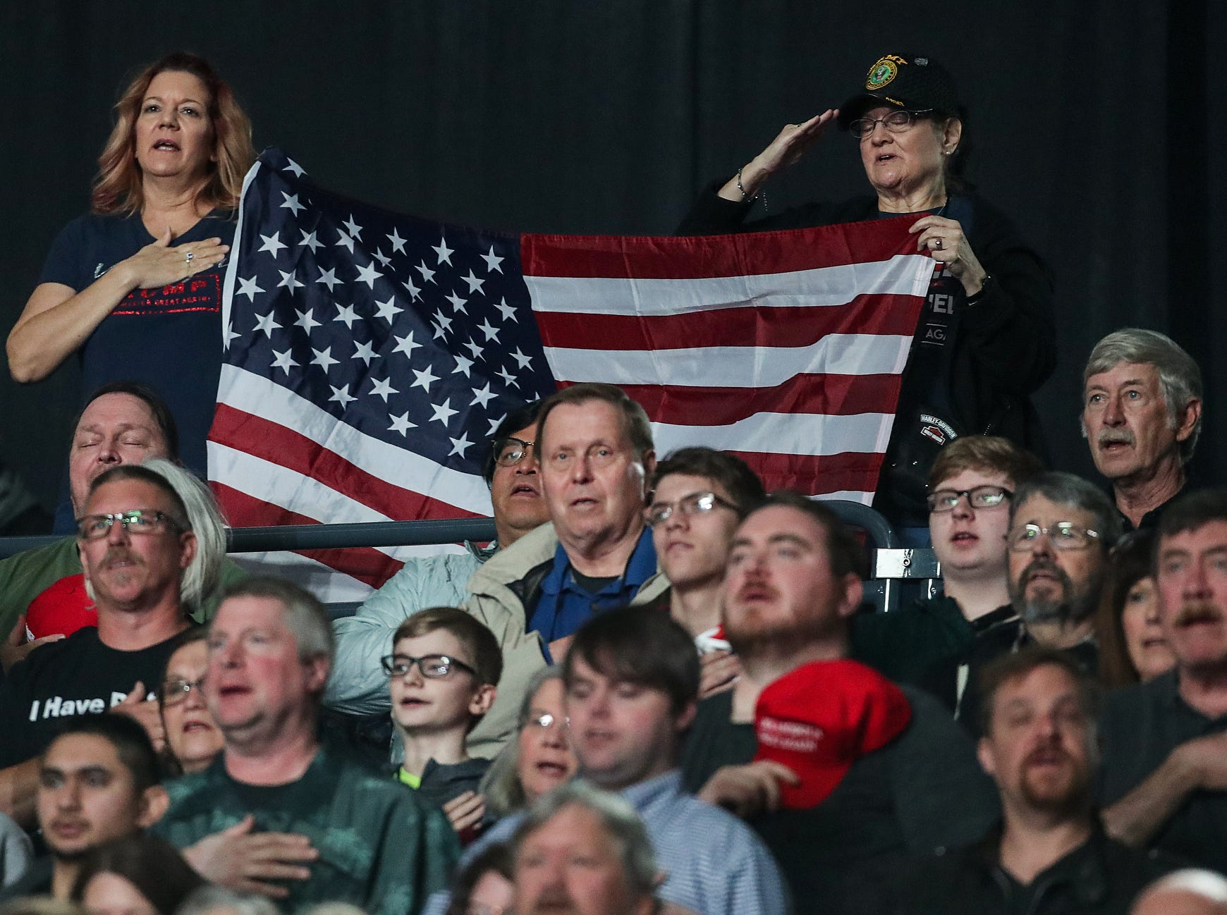 Spectators stand for the Pledge of Allegiance before the National Rifle Association Institute for Legislative Action Leadership Forum, Friday, April 26, 2019, at Lucas Oil Stadium in Indianapolis.