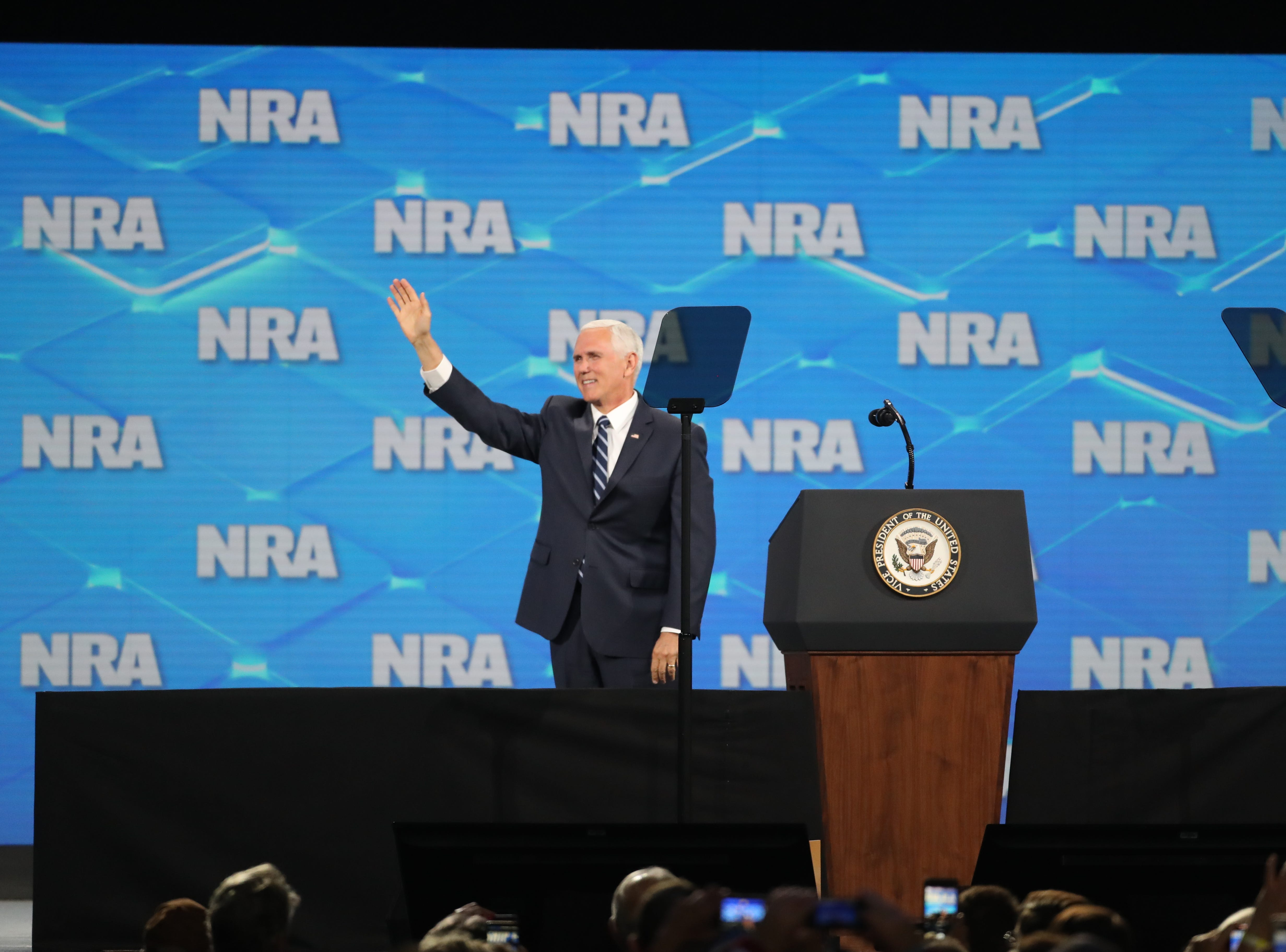 Vice President Mike Pence waves to the crowd before his speech at the NRA Institute for Legislative Action (NRA-ILA) Leadership Forum at Lucas Oil Stadium on Friday, April 26, 2019.