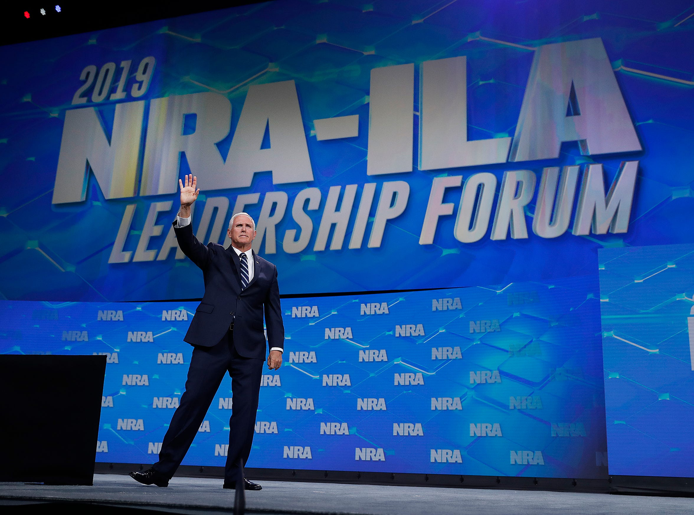 Vice President Mike Pence waves to his supporters at the NRA-ILA Leadership Forum at Lucas Oil Stadium on Friday, April 26, 2019.