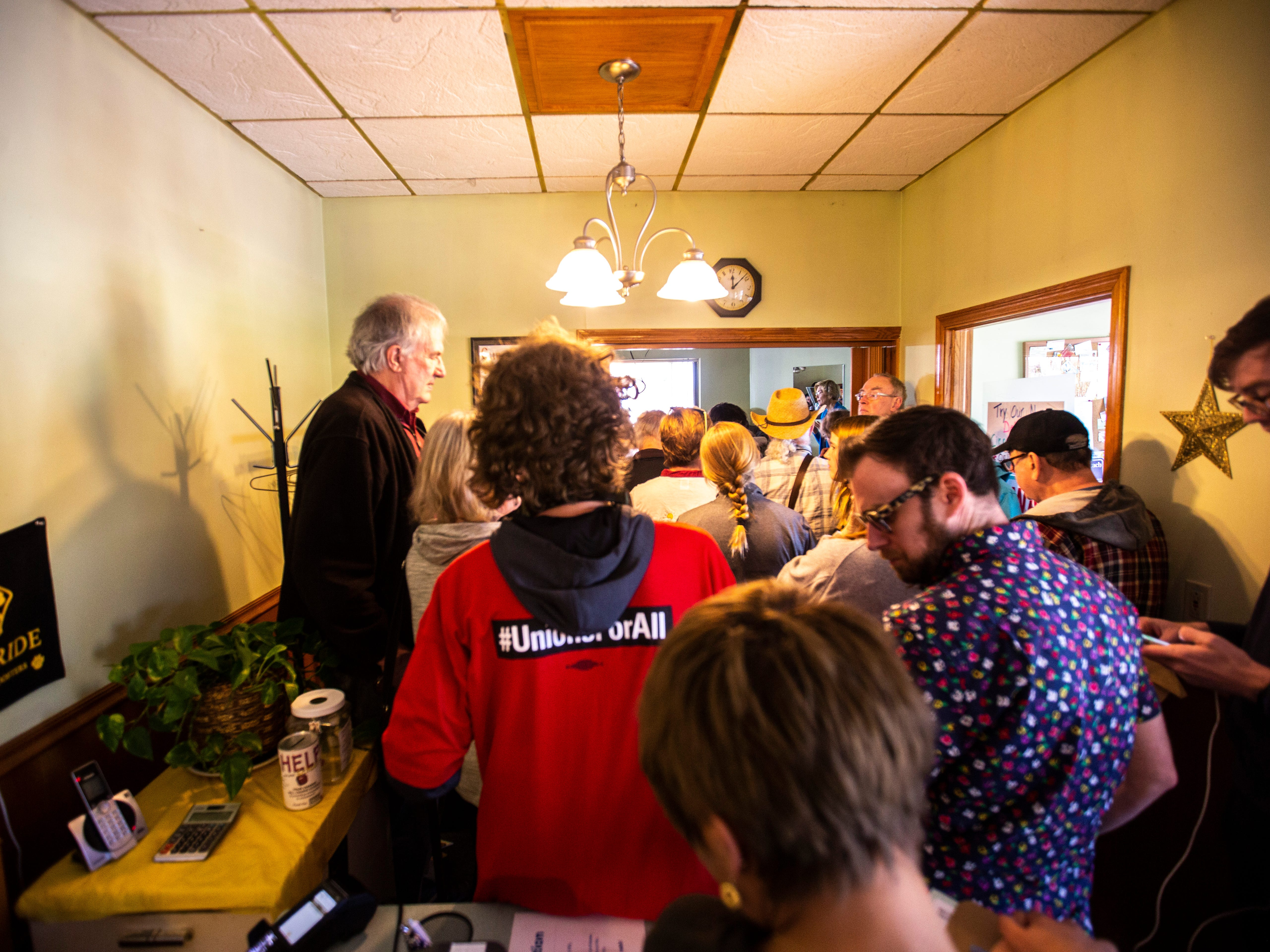 Supporters cram in the doorway while U.S. Sen. Elizabeth Warren, D-Mass., speaks during a campaign event, Friday, April 26, 2019, at the Tipton Family Restaurant in Tipton, Iowa.