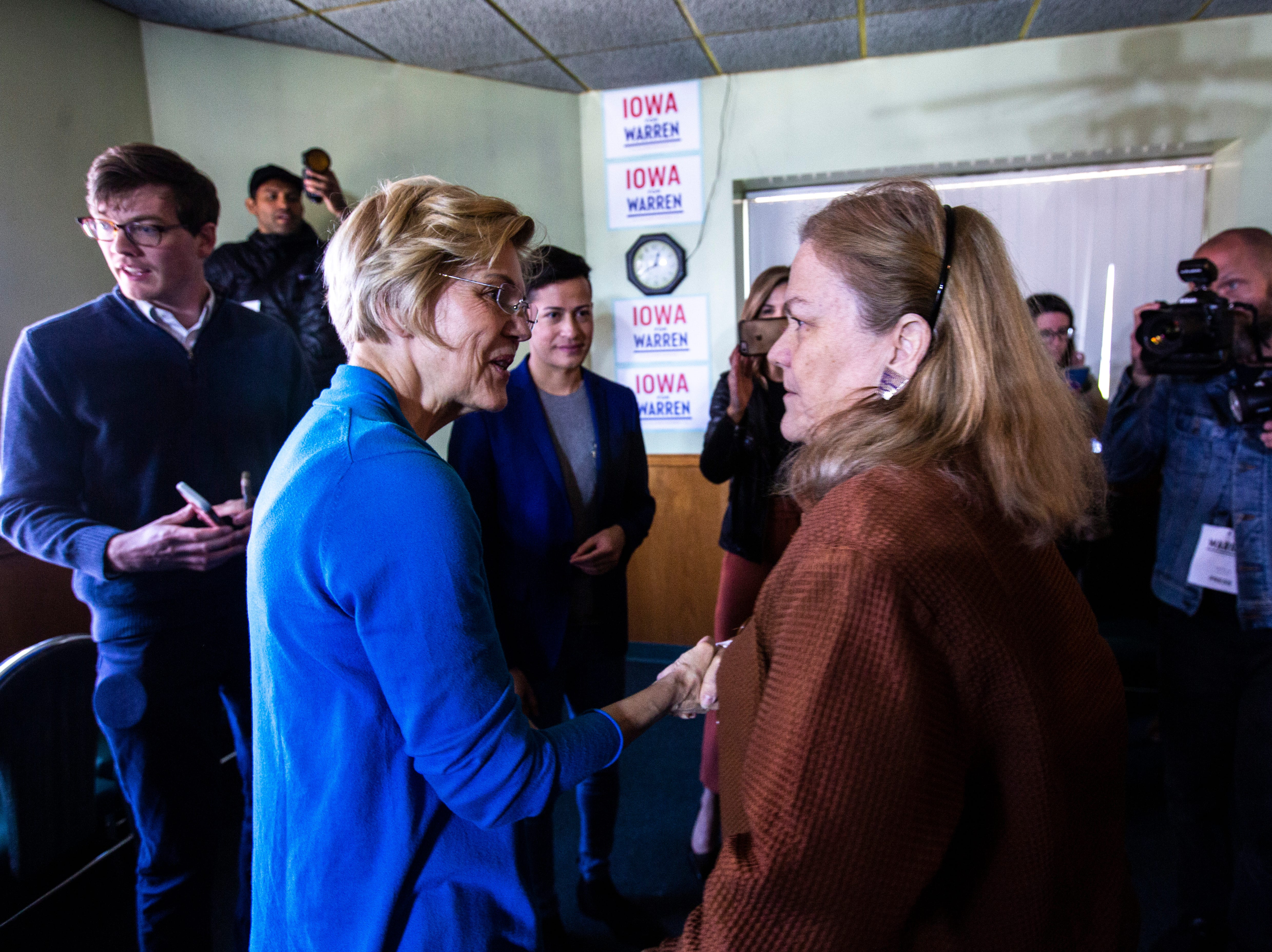 U.S. Sen. Elizabeth Warren, D-Mass., meets with people after a campaign event, Friday, April 26, 2019, at the Tipton Family Restaurant in Tipton, Iowa.