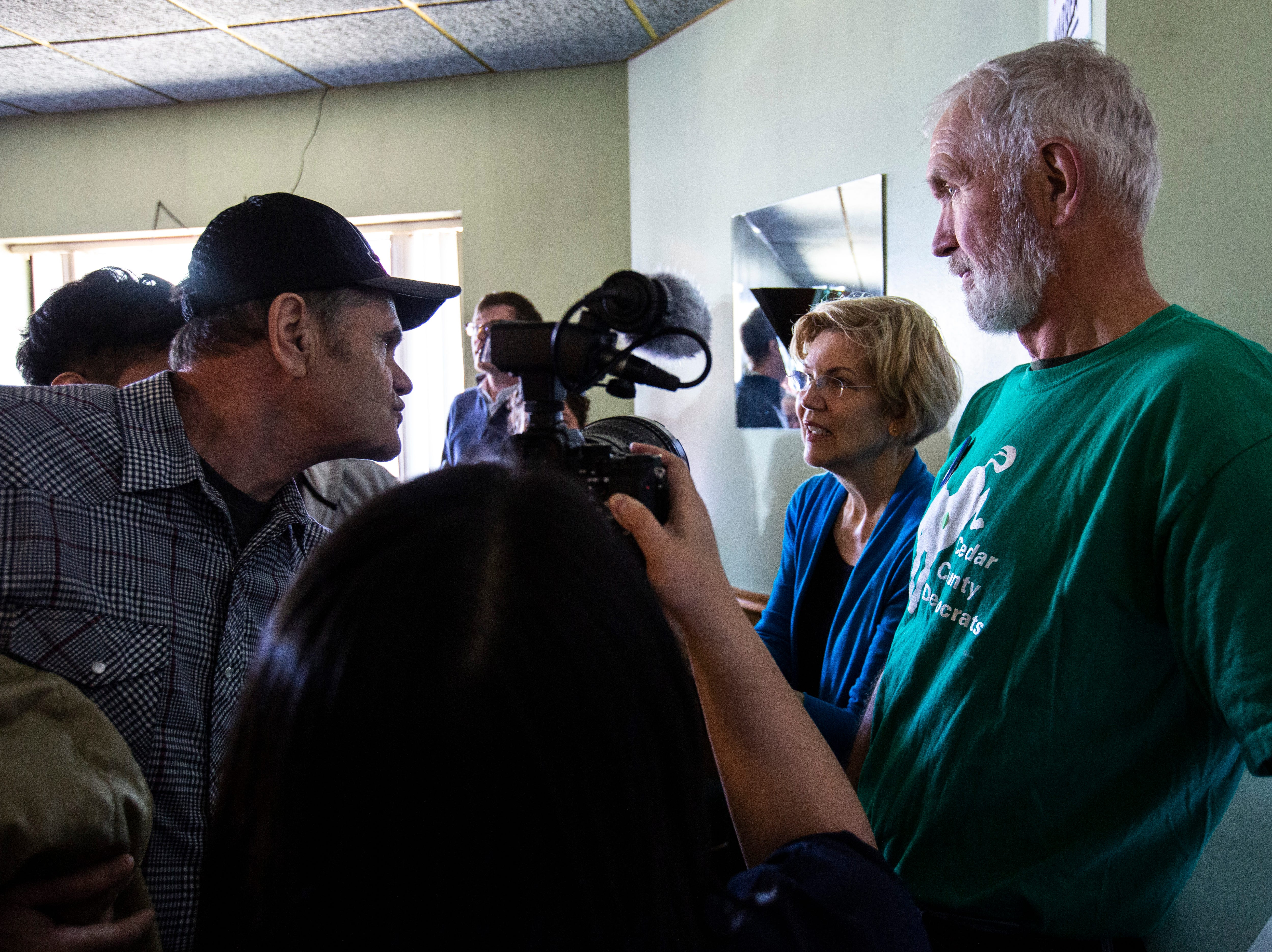 """U.S. Sen. Elizabeth Warren, D-Mass., shakes hands with a retired engineer Bill Sheeder, left, of Muscatine, during a campaign event, Friday, April 26, 2019, at the Tipton Family Restaurant in Tipton, Iowa. Sheeder traveled with to the event with his wife who is also retired. He has been following Warren's policies for the past three years and said he supports her because, """"She's a fighter."""""""