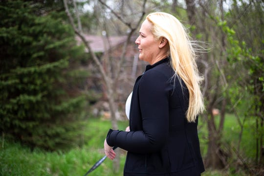 Tara Armstrong is pictured, Thursday, April 25, 2019, near her home in Iowa City, Iowa.