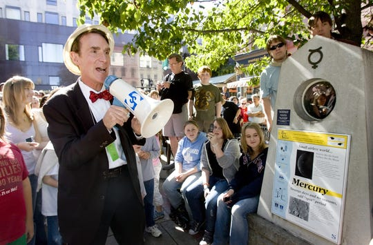 "Bill Nye ""The Science Guy"" leads a crowd through the Sagan Planet Walk starting in The Commons and ending at the Sciencenter in 2008. Nye contributed narration to an augmented reality app to complement the Planet Walk."
