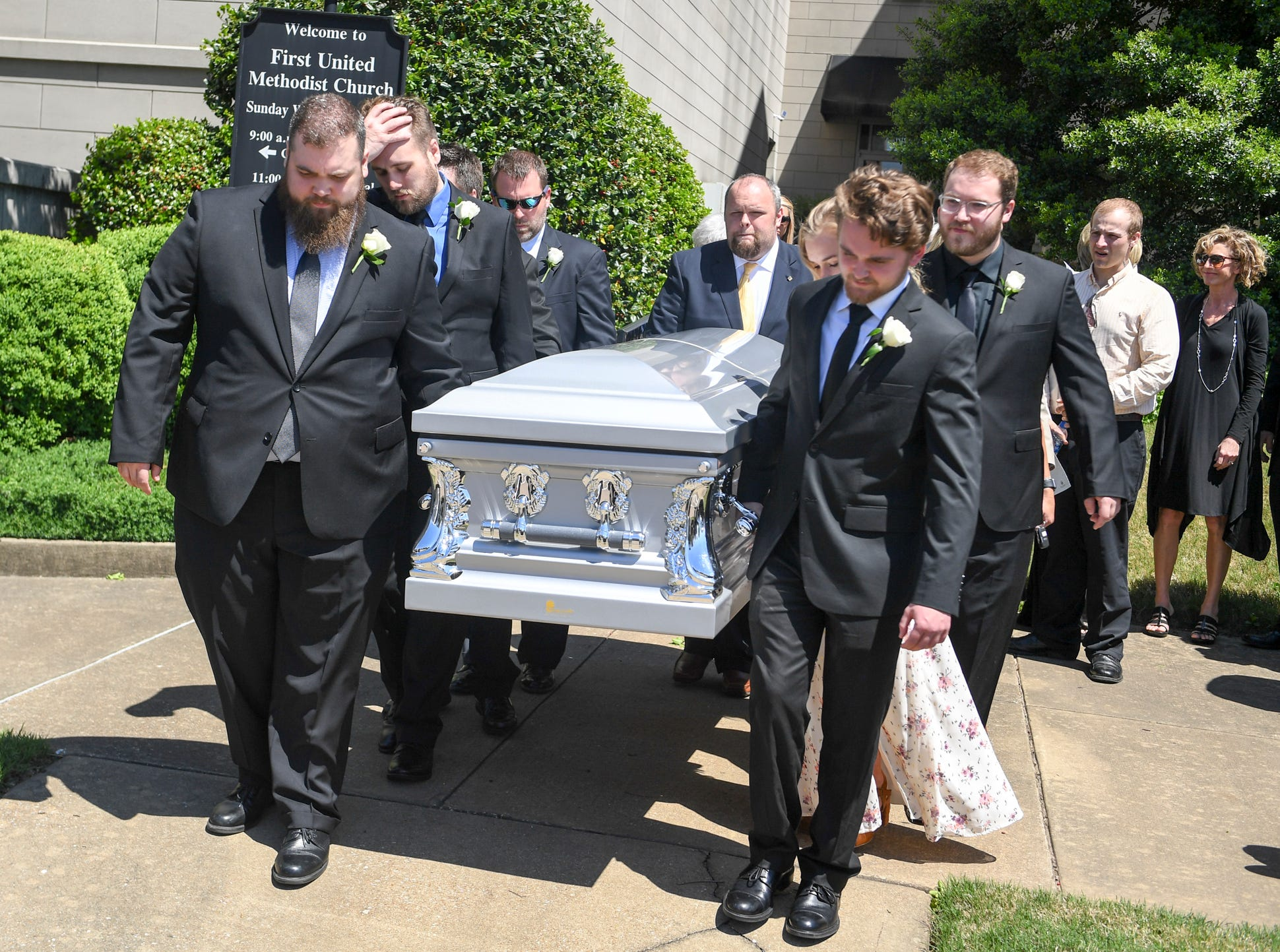 Pallbearers carry Henry Harrison's casket outside of First United Methodist Church after his Celebration of Life service, Friday, April 26, 2019.