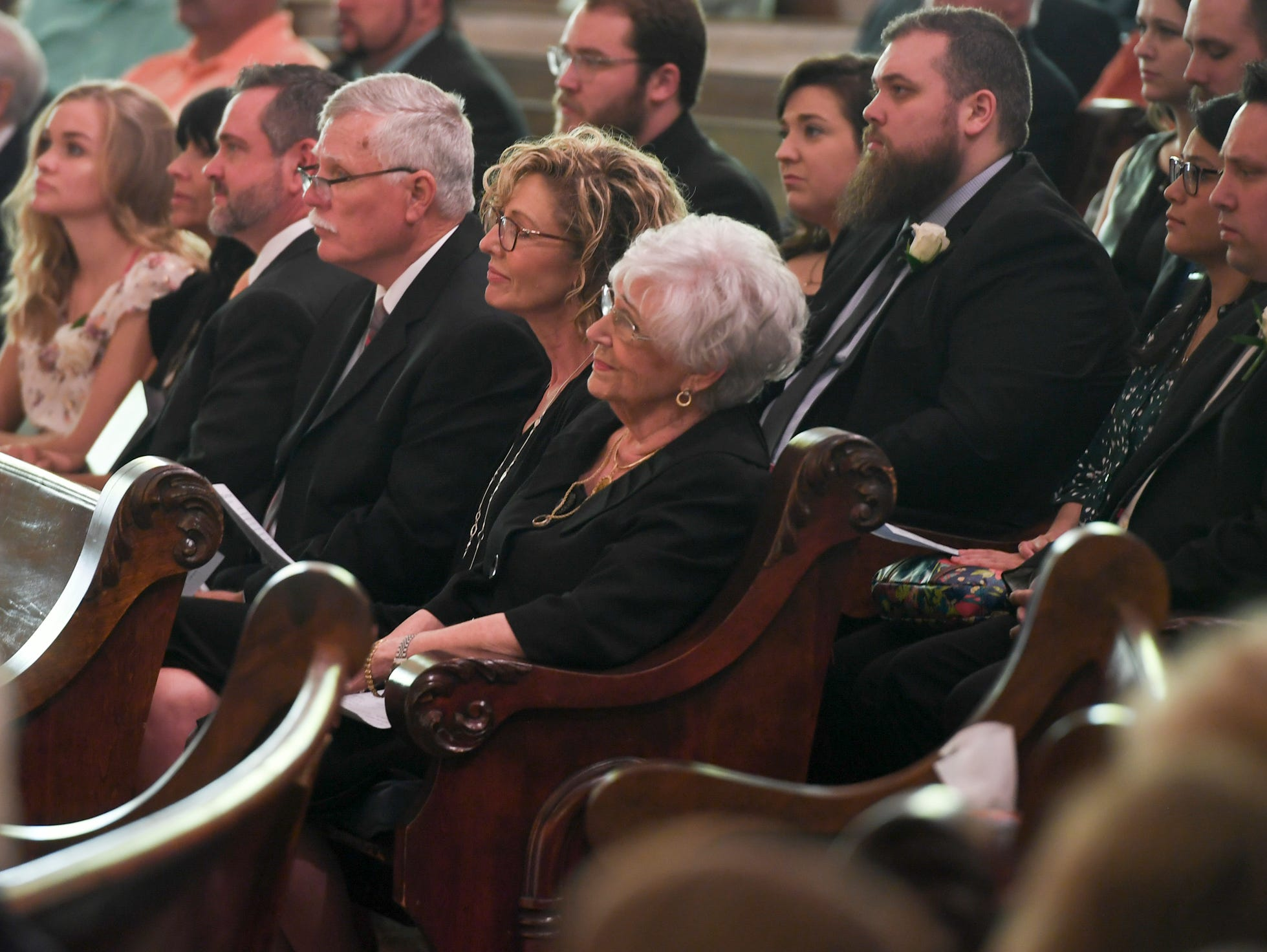 Margaret Harrison listens as the choir sings during the celebration of life of service of her husband Henry Harrison, Friday, April 26, 2019, at First United Methodist Church.