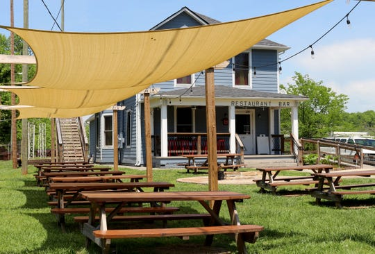 At Landing House, the front yard and porch are the best seats in the house.