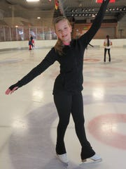 Skater Caroline Miller poses on the ice at the Ice Chalet.