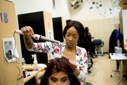4cb3e77f522 Mayika Evans does Carmen Pascual s hair for prom in the cosmetology class  at Austin-East