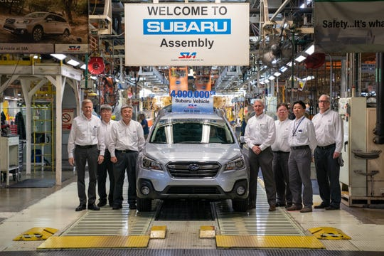 Subaru of Indiana Automotive officials stand around the four millionth vehicle, a 2019 Outback, of of the assembly line at the Lafayette plant.
