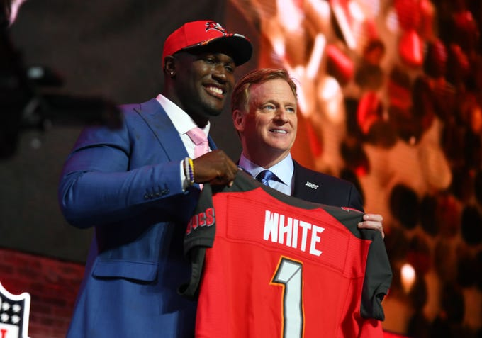 Apr 25, 2019; Nashville, TN, USA; Devin White (Louisiana State) stands with NFL commissioner Roger Goodell after he was selected as the number five overall pick to the Tampa Bay Buccaneers in the first round of the 2019 NFL Draft in Downtown Nashville. Mandatory Credit: Christopher Hanewinckel-USA TODAY Sports
