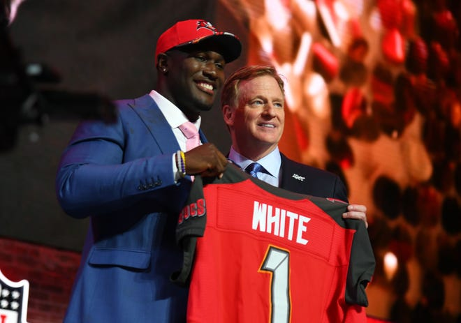 Devin White stands with NFL commissioner Roger Goodell after he was selected as the No. 5 overall pick to the Tampa Bay Buccaneers in the first round of the 2019 NFL Draft in Downtown Nashville.