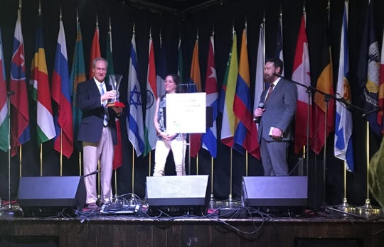 Warren Bares, president of J. Maxime Roy Inc., accepts the 20th International Achievement Award by the Lafayette International Center Foundation at the Festival International Opening Reception on Thursday, April 25, 2019.