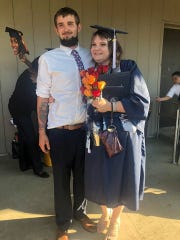 Justin Primeaux, left, stands with his sister, Leah Primeaux, after her graduation. The family of Justin Primeaux has set up a GoFundMe in the wake of the 23-year-old Cade man's murder last week.