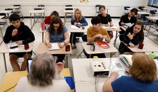 Fisher Catholic junior varsity quiz team members listen to questions from their coaches Michael Sedlack, bottom left, and Lynn Stevenson, bottom right, Thursday night, April 25, 2019, at Fisher Catholic High School in Lancaster. The team will compete Saturday at the National History Bee and Bowl in Washington, D.C.
