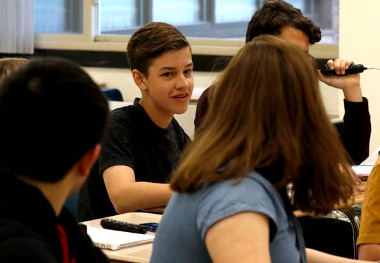 Francis Hanf, left, and Anna Tencza, right, look back at their teammate Dominic Blackston Thursday night, April 25, 2019, at Fisher Catholic High School in Lancaster during the a practice for the school junior varsity quiz team. The team will compete Saturday at the National History Bee and Bowl in Washington, D.C.