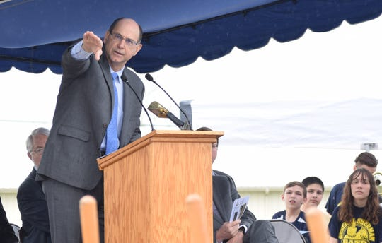 Lancaster City Schools Superintendent Steve Wigton points out features on the new General Sherman Junior High building during the construction kickoff ceremony April 25.