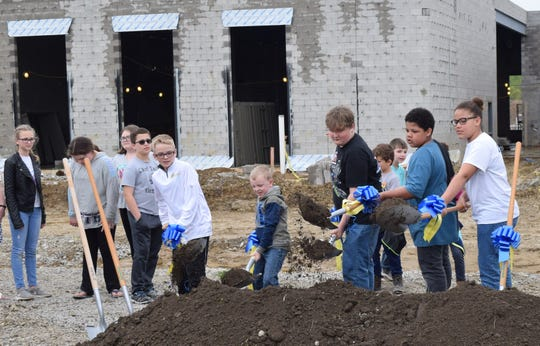 Lancaster elementary school students break ground during the construction kickoff ceremony for the new General Sherman Junior High on April 25. When the school is completed, these students will be some of the first to attend it.