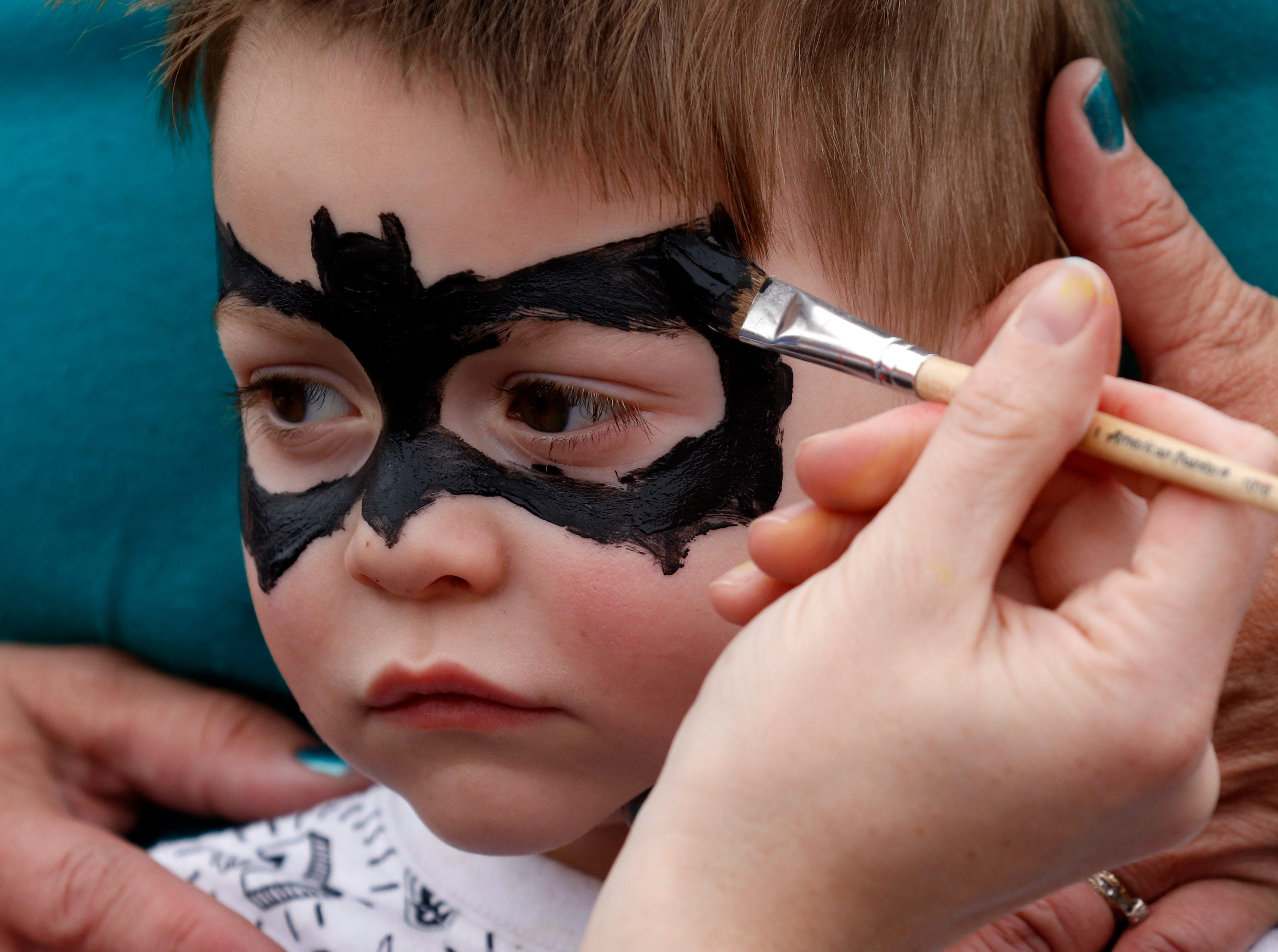 Dakota Rice, 2, from Zanesville, gets his face painted Thursday evening, April 25, 2019, during the Fairfield County Job and Family Services' annual Circus Night in downtown Lancaster.