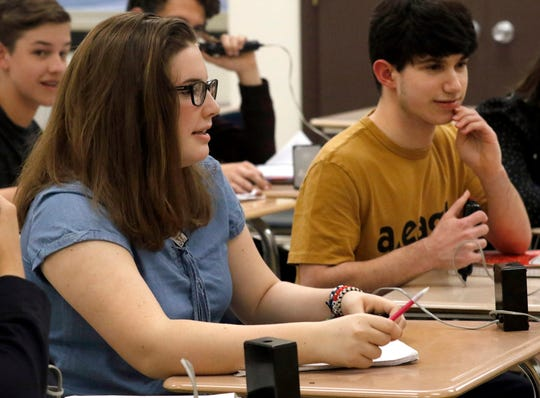 Anna Tencza, left, and Matthew McGonagle listen to questions from their coaches Thursday night, April 25, 2019, during quiz team practice at Fisher Catholic High School in Lancaster. The Fisher Catholic junior varsity quiz team will compete Saturday in the National History Bee and Bowl in Washington, D.C.