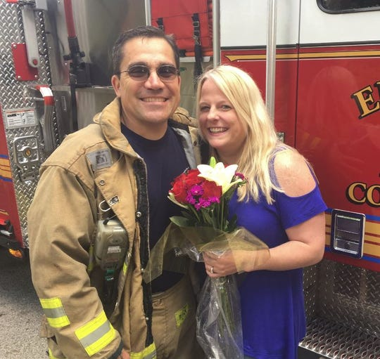 Firefighter Tom Cecil (left) and Manual High School teacher Allison Hunt smile after getting engaged during a fire drill. April 26, 2019