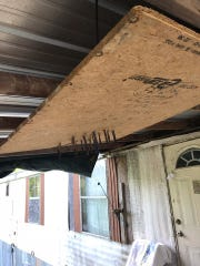 Deputies found a booby trap device featuring several knives sticking out of it on the front porch of Jackson's home.