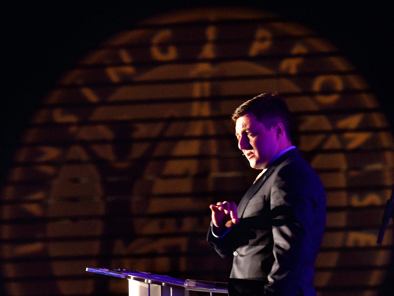Lansing Promise Executive Director Justin Sheehan speaks during the fifth-annual Lansing Promise Dinner on Thursday, April 25, 2019, at the Don Johnson Fieldhouse in Lansing.