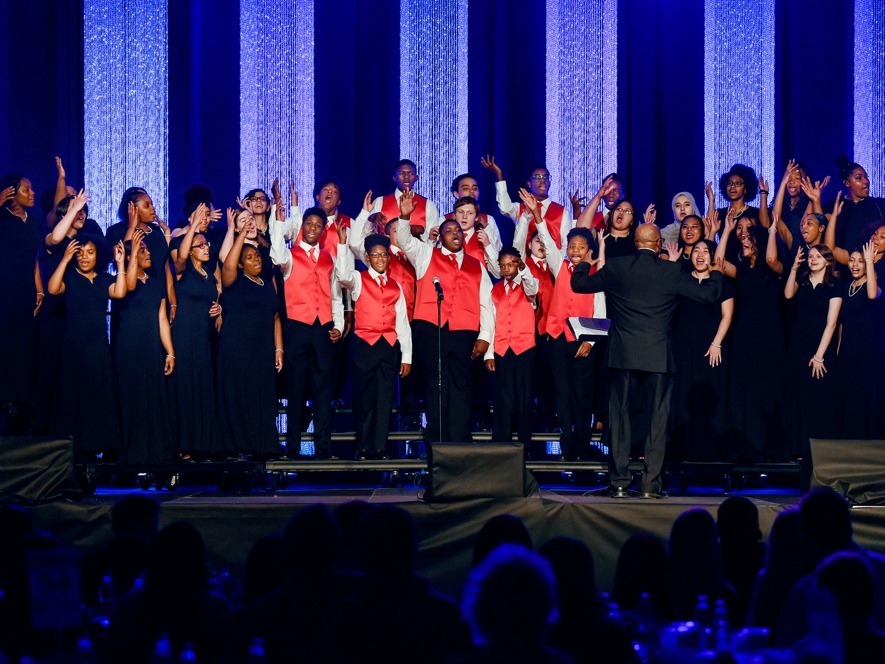A singing group from Sexton High School under the direction of Josh Hicks performs during the fifth-annual Lansing Promise Dinner on Thursday, April 25, 2019, at the Don Johnson Fieldhouse in Lansing.