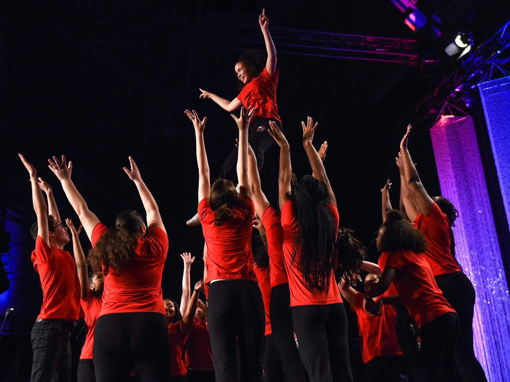 Members of the Everett High School dance team perform during the fifth-annual Lansing Promise Dinner on Thursday, April 25, 2019, at the Don Johnson Fieldhouse in Lansing.