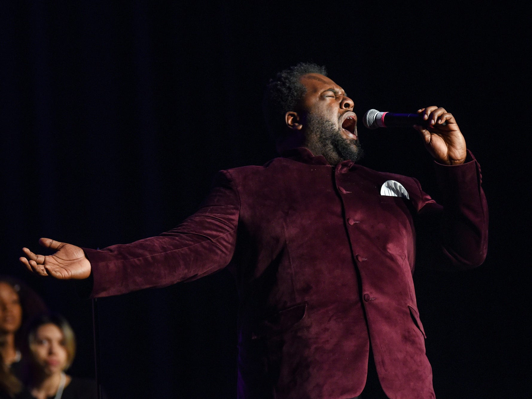 Musician LaVonte Heard sings during the fifth-annual Lansing Promise Dinner on Thursday, April 25, 2019, at the Don Johnson Fieldhouse in Lansing.