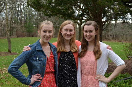 Triplets Abby, Seraphina and Zoey Provenzano, in a family photo taken by their father in April 2019, will all graduate from University of Michigan May 4, 2019. The triplets were all valedictorians at Alma High School in 2015.