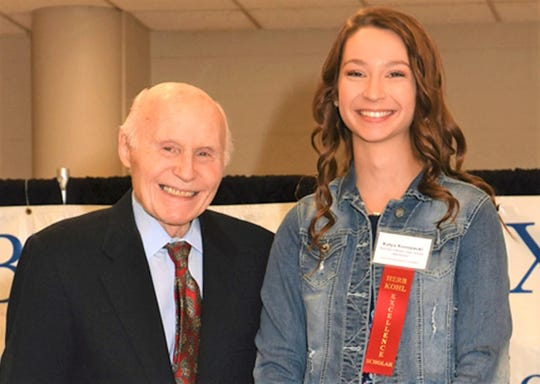 Roncalli's Katya Konopacki at a recognition luncheon hosted by Herb Kohl (left), Wisconsin philanthropist and businessman.