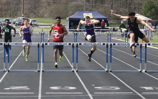 Mount Gilead's Connor Page (second from right) wins the 300 hurdles at the 87th Mehock Relays.